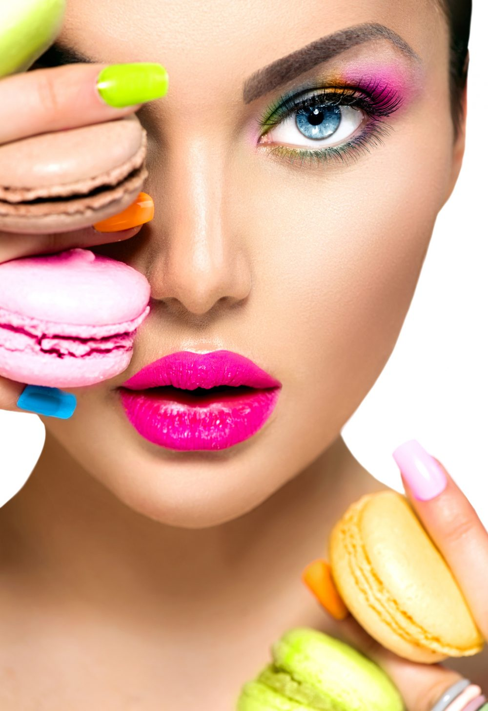 Beauty fashion model girl taking colorful macaroons